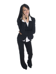 businesswoman laughing while talking on her cell phone.