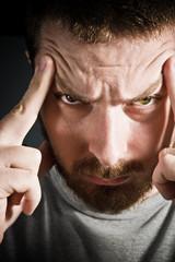 Stressed man suffering a big headache