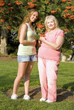 family mother and daughter outdoor admiring ashberry tree poster