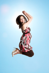 A beautiful asian woman jumping for joy