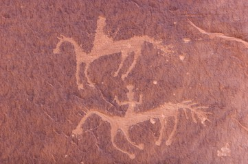 An image of carvings and ancient art on canyon walls