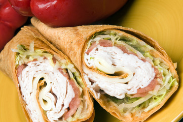 turkey and swiss cheese wrap sandwich with red bell peppers