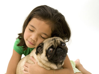 Child Hugging Pet