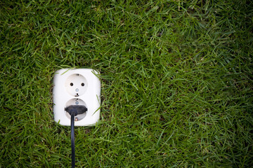 energy consept outllet in grass with a slight vignet