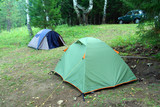 two tents outdoors - camping in forest poster
