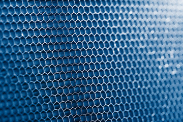 blue honeycomb grid, macro shot, shallow DOF