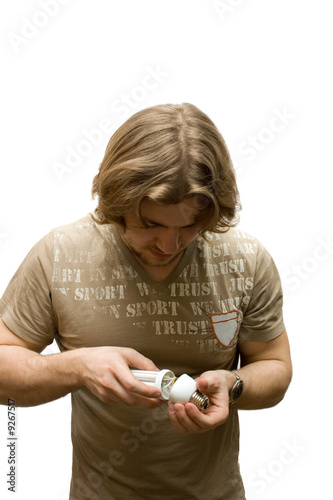 young man thinking on a lamp isolated on white