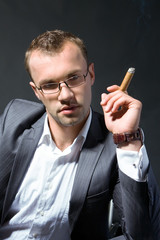 Portrait of a businessman smoking a cigar