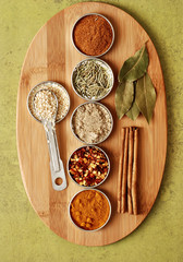 a variety of spices on a bamboo board