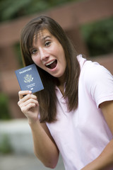 Excited traveller with her passport