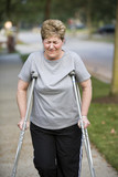 woman on crutches with pain poster