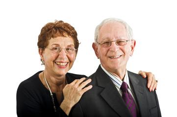 closeup senior couple smiling isolated on white