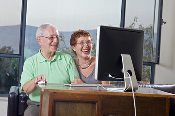 senior couple using an imac computer