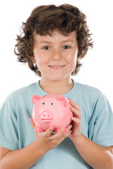 Adorable boy with pink piggy bank in his hands