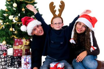 Christmas, happy couple with son, child next to Xmas tree
