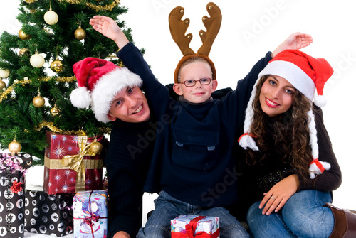 Christmas, happy couple with son, child next to Xmas tree