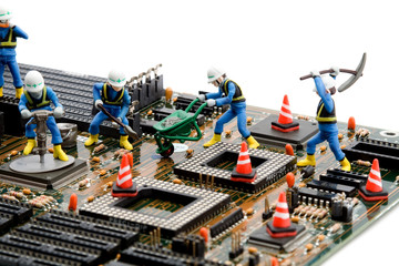 construction site - little workers repairing motherboard