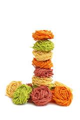 Towers from italian multicolored pasta tagliatelle