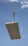 Hoisting crane lifts heavy concrete grey slab poster