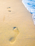 Background abstract: Footprint on sand with foam poster