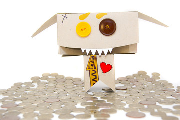 Metal coins and cardboard greedy person
