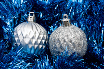 Silver glass balls on blue garland background