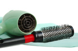 The hair dryer and hairbrush on a satin background poster