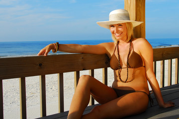 pretty woman relaxing at pavilion at beach