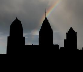 Philadelphia skyline with rainbow and dark clouds illustration