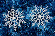 Snowflake on blue shiny garland making a background