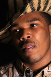 closeup of a young African American man in a safari hat poster