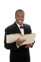 young African American preacher giving sermon,