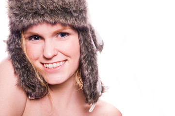 laughing girl in winter hat