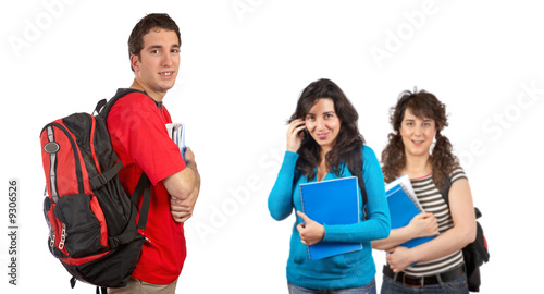 Students with backpacks over a white background. Focus at front