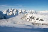 High mountains with ski tracks and ski lifts poster