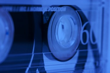 Audio cassette tape background in blue