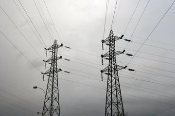 High voltage electric pillars, overcast sky