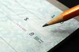 Stock pictures of checks used as a form of payment poster