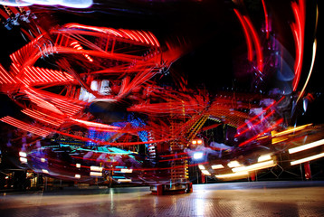 terrific speed of carousel in evening park