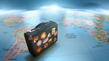 Vintage suitcase over world map