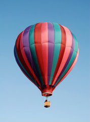 Colorful hot air balloon floating in blue sky