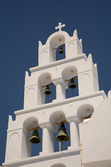 white bell tower in the greek island of santorini