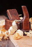 shaving and wooden plane,focus on a foreground poster