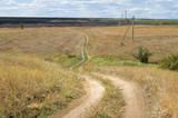 local steppe winding road across ravine poster