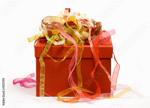 Red gift box with colorful ribbons on it