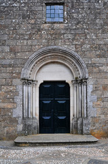 a church closed door with a window in the top