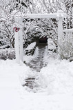 Path leading to a house after heavy snowfall poster
