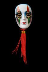 Nice ceramic venetian mask hanging on dark background