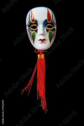 Nice ceramic venetian mask hanging on dark background