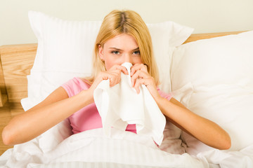 Photo of sick woman sitting in bed